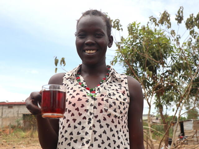 Mary,  a mother of 4, selling tea to support her family