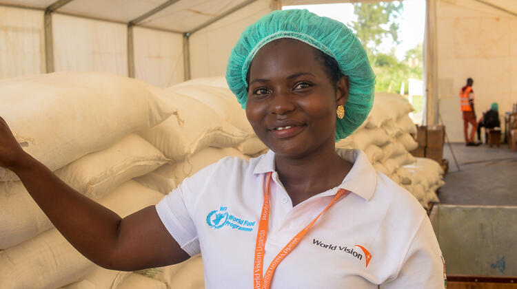 Suzan is a distribution staff worker who helps distribute food.