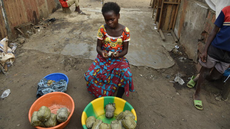 Marie* selling Chikwangue in a community market.