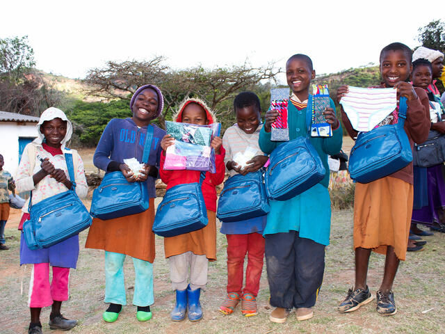 All smiles when children and parents in Zimbabwe received hygiene kits.