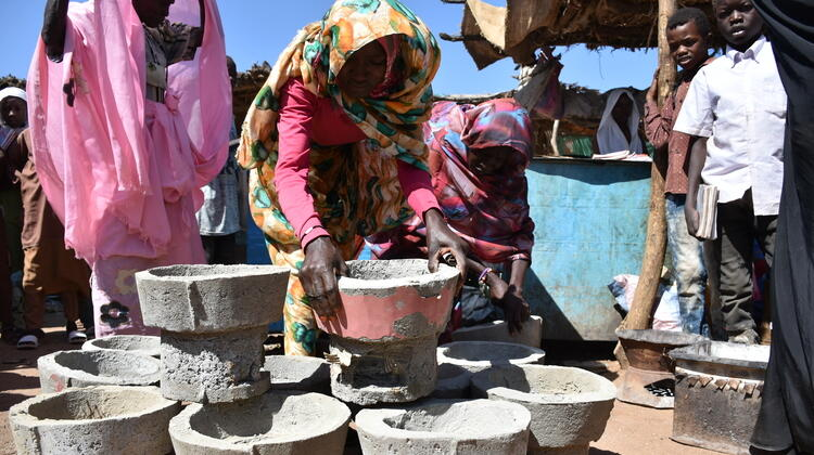 The stoves business is promising for a few women World Vision team met at the Duma market, including Elham.