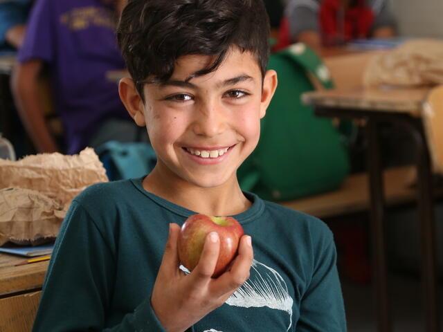 Children receiving nutritional meals at school