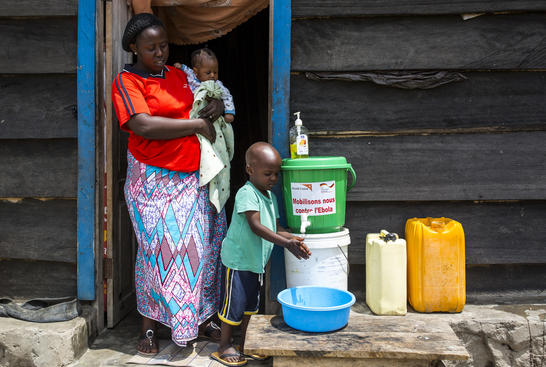 Family with handwashing station to prevent Ebola