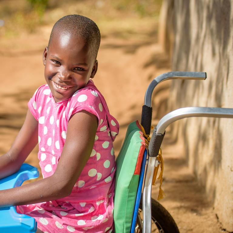 A girl sitting in a wheelchair