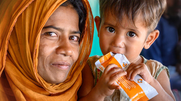 Mother and son with emergency meal pack