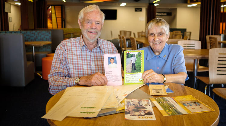 John and Patricia Howard with sponsored children letters